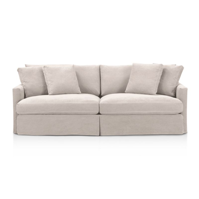 """Tailored to fit our Lounge Slipcovered 93"""" Sofa, smart denim slipcover is tailored with a kickpleat skirt and jumbo double topstitch outlining its high slim arms and plump, deep cushions.<br /><br />Additional <a href=""""http://crateandbarrel.custhelp.com/cgi-bin/crateandbarrel.cfg/php/enduser/crate_answer.php?popup=-1&p_faqid=125&p_sid=DMUxFvPi"""">slipcovers</a> available below and through stores featuring our Furniture Collection.<br /><br />After you place your order, we will send a fabric swatch via next day air for your final approval. We will contact you to verify both your receipt and approval of the fabric swatch before finalizing your order.<br /><br /><NEWTAG/><ul><li>100% cotton</li><li>Machine washable</li><li>Jumbo contrast topstitching detail</li><li>Made in North Carolina, USA</li></ul><br />"""