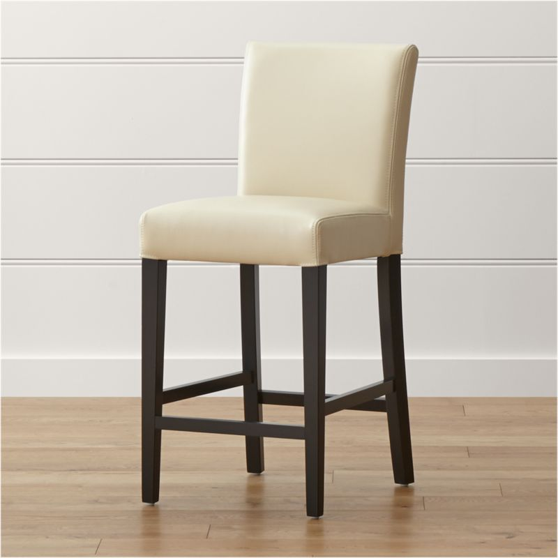 Our stylish and contemporary Lowe counter stool is smartly upholstered in chic ivory bicast leather with a soft, pebbled texture and double saddle-stitch tailoring. Long and lean with a classic Parsons-style design, this counter stool features a cushioned tight seat and back perfectly proportioned to the frame's slim ebony-stained legs. <NEWTAG/><ul><li>Solid birch and engineered wood</li><li>Corner blocked joinery</li><li>Web suspension</li><li>Foam cushioning with fiber wrap</li><li>Legs with ebony finish</li><li>Upholstered in bicast leather with double saddle-stitching</li><li>Designed and tested for use in commercial spaces such as offices, restaurants and hotels</li><li>Made in China</li></ul>