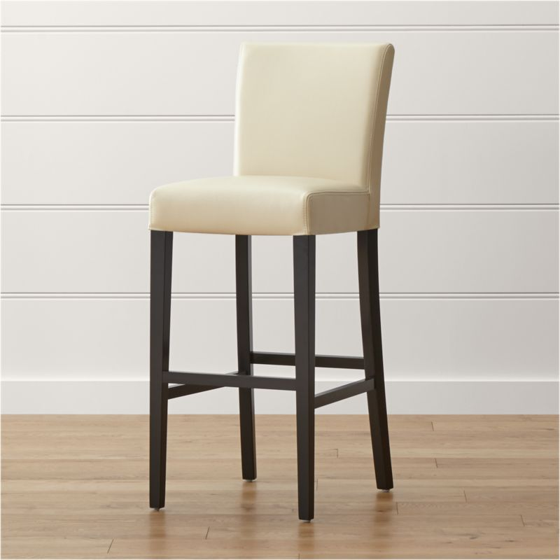 This stylish and contemporary bar stool with a classic Parsons heritage was designed and tested for use in commercial spaces such as offices, restaurants and hotels. Upholstered in chic ivory bicast leather with a soft, pebbled texture and double saddle-stitch tailoring, the Lowe bar stool is long and lean, with a roomy, cushioned tight seat and back perfectly proportioned to the frame's slim ebony-stained legs. <NEWTAG/><ul><li>Solid birch and engineered wood</li><li>Corner blocked joinery</li><li>Web suspension</li><li>Foam cushioning with fiber wrap</li><li>Legs with ebony finish</li><li>Upholstered in bicast leather with double saddle-stitching</li><li>Designed and tested for use in commercial spaces such as offices, restaurants and hotels</li><li>Made in China</li></ul>