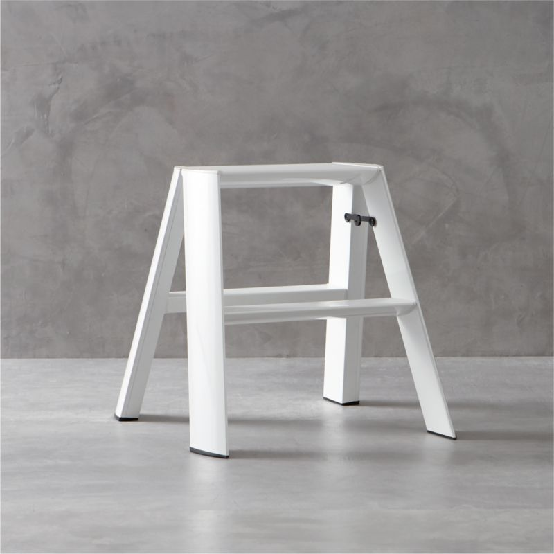 """The beauty is in the details when it comes to this meticulously designed step-stool. Expertly crafted and assembled by hand, and finished with a durable white powdercoated finish, smooth aluminum and steel form triangular tubes that meet in a slim, graceful profile. From the secure safety latch and non-skid feet to safety-minded steps with integrated grooves for tread, each and every element is thoughtfully considered—even the fastening screws are hidden. Sturdy yet surprisingly lightweight, this ladder weighs only 10 lbs. for easy portability and supports up to 300 lbs. in weight. Engineered to fold to a streamlined 8.25"""" deep, it can also stand on its own without having to lean against the wall. Created by the experimental design lab Metaphys and Hasegawa Kogyo Co., the top manufacturer of ladders and scaffolding in Japan since 1956, this exceptional ladder has received many design accolades, including the RedDot Design, Good Design and JIDA Design Museum selection awards.<br /><br /"""