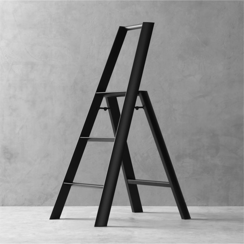 "The beauty is in the details when it comes to this meticulously designed 3-step ladder. Expertly crafted and assembled by hand, and finished with a satin black powdercoated finish, smooth aluminum and steel form triangular tubes that meet in a slim, graceful profile. From the secure safety latch and non-skid feet to safety-minded steps with integrated grooves for tread, each and every element is thoughtfully considered—even the fastening screws are hidden. Sturdy yet surprisingly lightweight, this ladder weighs only 11 lbs. for easy portability and supports up to 300 lbs. in weight. Engineered to fold to a streamlined 7"" deep, it can also stand on its own without having to lean against the wall. Created by the experimental design lab Metaphys and Hasegawa Kogyo Co., the top manufacturer of ladders and scaffolding in Japan since 1956, this exceptional ladder has received many design accolades, including the RedDot Design, Good Design and JIDA Design Museum selection awards.<br /><br /><NEWTAG/><ul>"