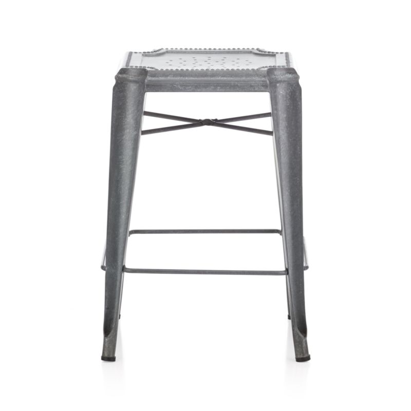 All the charm and character of a flea market find, our galvanized steel stool is crafted with unique reverse-arched legs and distinctive beading and decorative perforations. The hot-dip galvanizing process creates random formations of spangles, and each stool gets a dose of hand distressing, ensuring that each piece is truly unique. Lightweight yet sturdy stools stack up to four high for indoor or outdoor use.<br /><br /><NEWTAG/><ul><li>Die cut and welded mild steel sheet</li><li>Galvanized finish with clear powdercoat</li><li>For indoor or outdoor use; outdoor use may develop patina and white spots</li><li>Stack up to four high</li><li>Plastic glides</li><li>Made in India</li></ul>