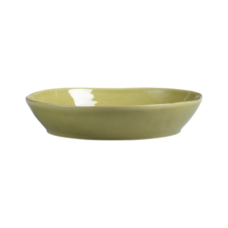 Artisanal ceramic shapes are glazed a soft green with subtle hand-antiquing on the freeform rims. Also available in white.<br /><br /><strong>Please note:</strong> The Marin Green Centerpiece Bowl will be discontinued in January 2013. When our current inventory is sold out, it is unlikely we will be able to obtain more.<br /><br /><NEWTAG/><ul><li>Stoneware</li><li>Dishwasher-, microwave- and oven-safe to 300 degrees</li><li>Made in Portugal</li></ul>