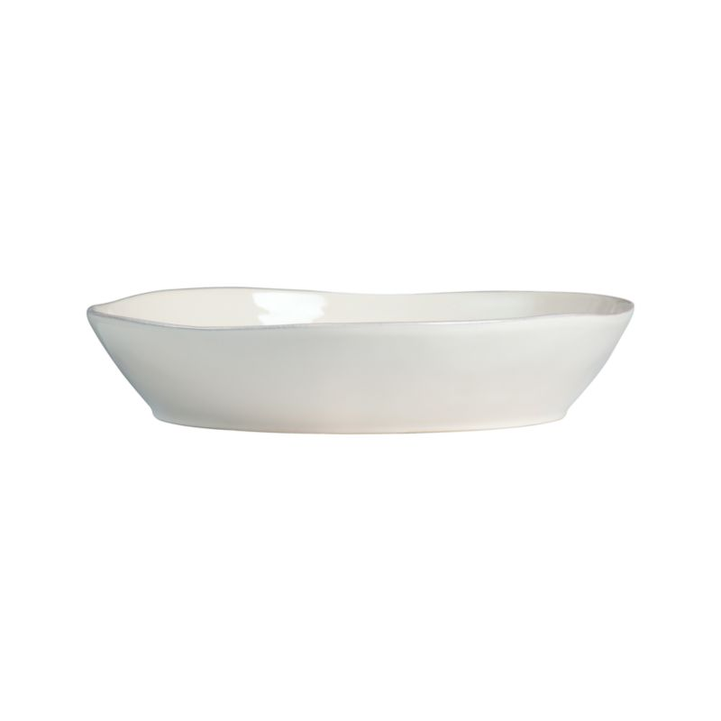 Artisanal ceramic shapes are glazed a soft white with subtle hand-antiquing on the freeform rims. Also available in green.<br /><br /><NEWTAG/><ul><li>Stoneware</li><li>Dishwasher-, microwave- and oven-safe to 300 degrees</li><li>Made in Portugal</li></ul>