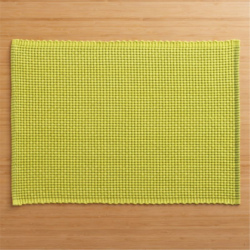 Hand-dyed, hand-woven cotton placemat textures chunky and graphic in pure, vivid color.<br /><br /><NEWTAG/><ul><li>100% cotton</li><li>Oversized to allow for shrinkage</li><li>Machine wash, reshape and dry flat</li><li>Made in India</li></ul>