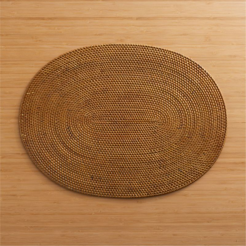 Island dining chic in a woven fiber oval with warm honey finish.<br /><br /><NEWTAG/><ul><li>Placemat is 60% ate, 40% rattan</li><li>Clean placemat with a damp cloth</li><li>Made in Indonesia</li></ul>