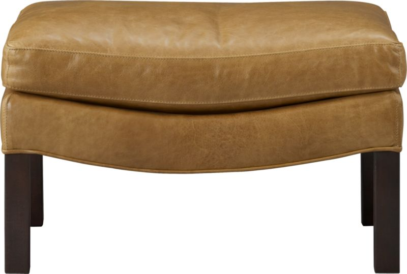 Sleek ottoman takes a curve in top-grain, full-aniline caramel leather, offering a leg up on luxurious relaxing. Subtly curved base props a plush cushion, accented with topstitched self-welting and distressed-finish legs.<br /><br />After you place your order, we will send a leather swatch via next day air for your final approval. We will contact you to verify both your receipt and approval of the leather swatch before finalizing your order.<br /><br /><NEWTAG/><ul><li>Solid maple with plywood</li><li>Top-grain, full-aniline leather</li><li>Synthetic webbing</li><li>Cushion is soy-based poly foamcore with fiber wrapped in feather-down blend</li><li>Walnut leg with distressed finish</li><li>Topstitched self-welt</li><li>Made in North Carolina, USA</li></ul>