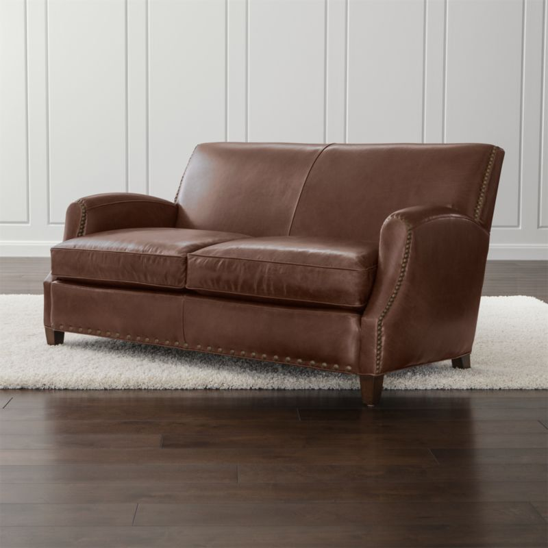 Inspired by a 1930s Parisian club chair, our Metropole leather loveseat is an heirloom in the making. Its signature brass nailheads accent rich leather finished at a 150-year-old tannery known for its Old World artisanry. <NEWTAG/><ul><li>Frame is benchmade in the USA with certified sustainable hardwood that's kiln-dried to prevent warping</li><li>Eight-way hand-tied suspension system</li><li>Soy-based polyfoam seat cushion wrapped in regenerated synthetic fiber and encased in downproof ticking</li><li>Soy-based polyfoam and regenerated synthetic fiber-filled tight back</li><li>Brass nailhead trim</li><li>Hardwood legs with a chestnut stain</li><li>Material origin: see swatch</li><li>Made in North Carolina, USA</li></ul>