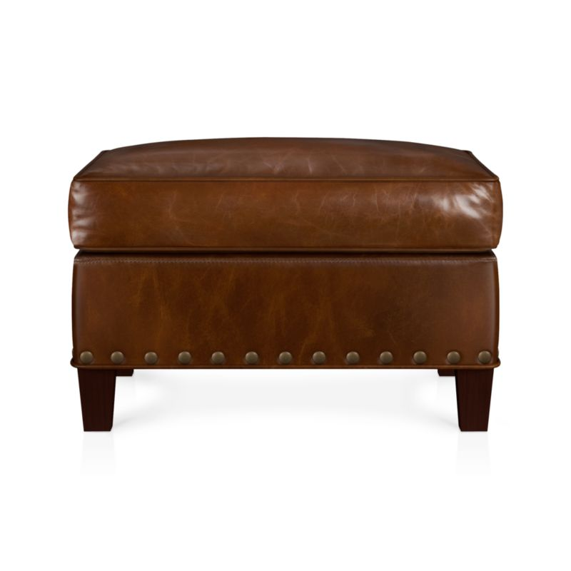 Crafted with all the rich detail of a classic 1930s antique, in a full-grain Brompton leather finished at a 150-year-old tannery known for its Old World artisanry. Hand-applied brass nailheads. Legs are finished in a vintage chestnut stain. Each ottoman will truly be one of a kind due to natural wrinkles and scarring in the hide and an innovative tannage technique that highlights the leather's natural tones and rich colors.<br /><br />After you place your order, we will send a leather swatch via next day air for your final approval. We will contact you to verify both your receipt and approval of the leather swatch before finalizing your order.<br /><br /><NEWTAG/><ul><li>Eco-friendly construction</li><li>Certified sustainable, kiln-dried hardwood frame</li><li>Cushion is soy-based polyfoam wrapped in regenerated synthetic fiber and encased in downproof ticking</li><li>Eight-way hand-tied suspension</li><li>Full-aniline leather</li><li>Brass nailhead trim</li><li>Hardwood legs have a chestnut stain</li><li>Benchmade</li><li>See additional frame options below</li><li>Made in North Carolina, USA</li></ul>