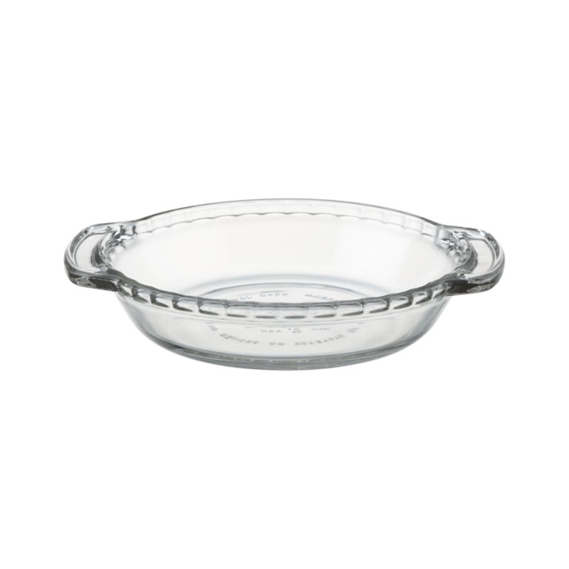 "The mini version of the American kitchen classic with fluted ""crust"" edge makes individual servings of pies, tarts, quiches, pot pies and casseroles. Glass bakes evenly and allows monitoring of bottom crust.<br /><br /><NEWTAG/><ul><li>Clear glass</li><li>Dishwasher-, microwave-, freezer- and oven-safe to 425 degrees</li><li>Made in USA</li></ul>"
