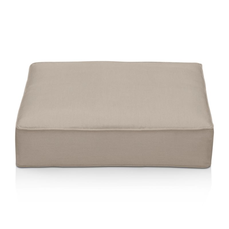 Thick cushion in fade- and mildew-resistant Sunbrella acrylic adds plush comfort to our Ventura ottoman. The Ventura Outdoor Sunbrella Ottoman Cushion is a Crate and Barrel exclusive.<br /><br /><NEWTAG/><ul><li>Fade- and mildew-resistant Sunbrella acrylic</li><li>Foam fill</li><li>Material origin: see swatch</li><li>Made in USA</li></ul>