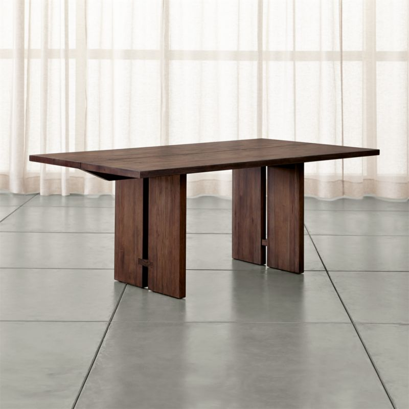 Our smaller Monarch rectangular dining table is handcrafted using centuries-old techniques in a modern way. Chosen for their beautiful cathedral graining, rare lengths of solid walnut are united with traditional Chinese butterfly joinery without using nails or screws. <NEWTAG/><ul><li>Solid walnut</li><li>Shiitake finish and water-based polyurethane topcoat</li><li>Traditional wood-on-wood joinery</li><li>Seats six</li><li>Made in China</li></ul>
