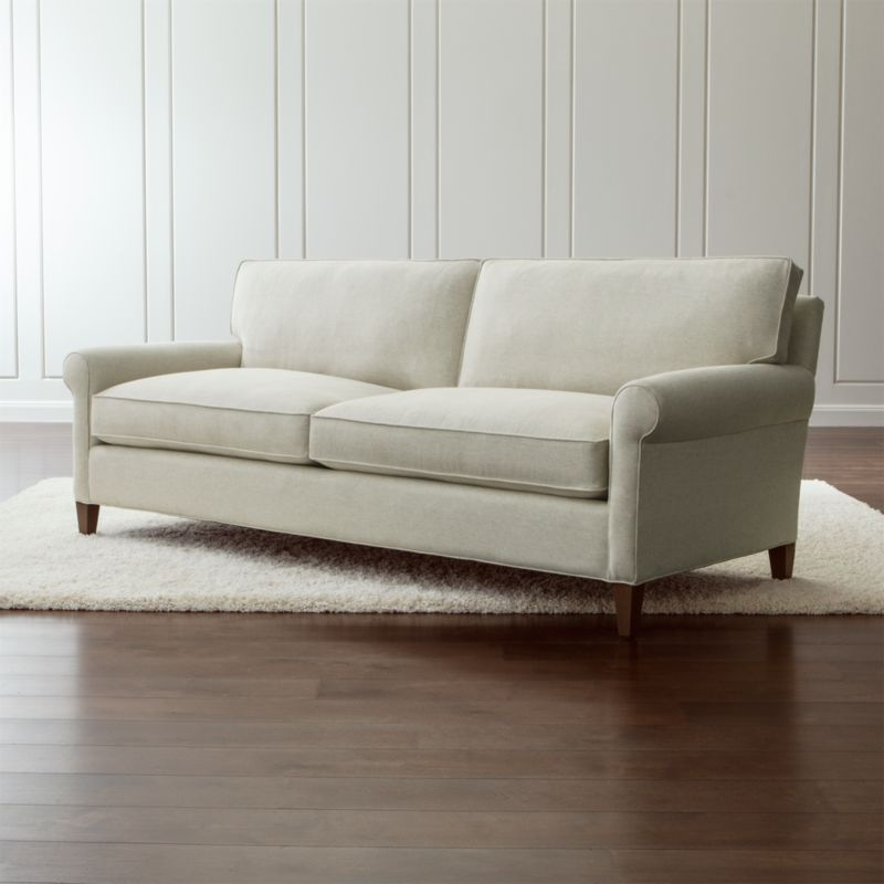 Well-balanced and beautifully tailored, Montclair is a model of classic proportions. Trim roll arms set the tone for this refined, 2-seat living room sofa that sits a bit more upright—not too low, not too deep—but with plenty of comfort. <NEWTAG/><ul><li>Frame is benchmade in USA with a certified sustainable hardwood that's kiln-dried to prevent warping</li><li>Flexolator spring suspension system</li><li>Soy-based polyfoam seat cushions wrapped in fiber-down blend and encased in downproof ticking</li><li>Fiber-down blend back cushions encased in downproof ticking</li><li>Hardwood legs stained with a light brown finish</li><li>Material origin: see swatch</li><li>Made in North Carolina, USA</li></ul>