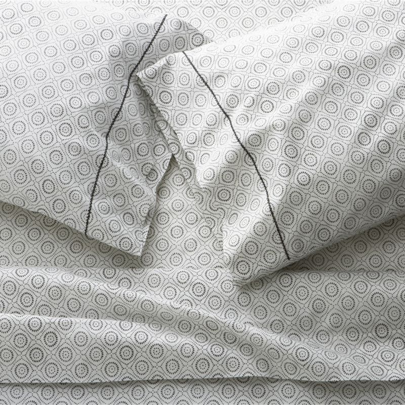 Traditionally block-printed bed linens spill fresh modern pattern on super-soft cotton. Concentric medallion motif is carved into a wooden block that is then carefully pressed and repeated for a versatile all-over print that makes a natural partner with solids and mixes well with other prints. Pillowcases are accented along one side with black hand-embroidered stitching. Sheet set includes one flat sheet, one fitted sheet and two standard pillowcases. Bed pillows also available.<br /><br /><NEWTAG/><ul><li>Handcrafted</li><li>100% cotton percale</li><li>200-thread-count</li><li>Machine wash, tumble dry</li><li>Made in India</li></ul>