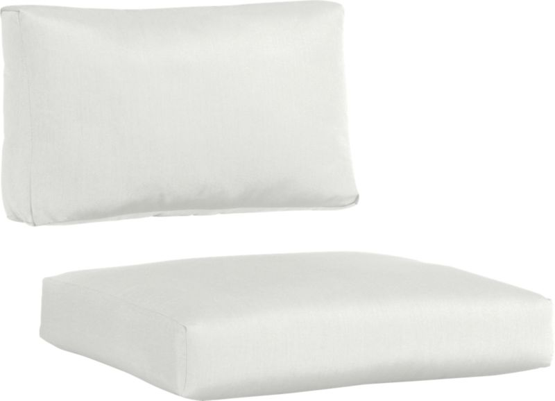 Warm white white sand cushions add a soft silhouette to our Newport lounge collection. Polyester-filled cushions are covered in fade-, water- and mildew-resistant Sunbrella® acrylic fabric.<br /><br /><NEWTAG/><ul><li>Fade- and mildew-resistant Sunbrella® acrylic</li><li>100% polyester fill</li><li>Cover or store inside during inclement weather</li><li>Spot clean</li><li>Made in USA</li></ul>