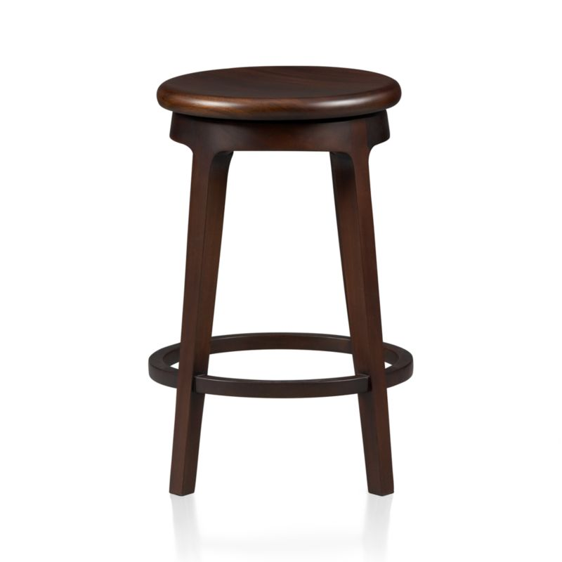 "Simple lines, warm mahogany and a 360-degree swivel seat elevates casual seating at bar, kitchen island or drafting table. Handcrafted stools have contoured seat and all-round circular footrest. Environmentally sourced mahogany is certified by the Forest Steward Ship Council (FSC), a nonprofit organization that encourages responsible management of the world's forests.<br /><br /><NEWTAG/><ul><li>FSC-certified solid mahogany with clear lacquer finish</li><li>Mortise-and-tenon joinery</li><li>Swivel seat</li><li>Dust with dry cloth</li><li>Protect from heat and liquids;</li><li>For indoor use only; avoid direct sunlight</li><li>24""H seat is sized for counters</li><li>Made in Indonesia</li></ul>"