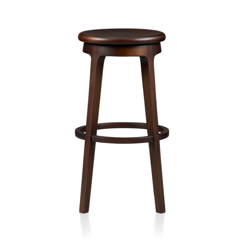 "Simple lines, warm mahogany and a 360-degree swivel seat elevates casual seating at bar, kitchen island or drafting table. Handcrafted stools have contoured seat and all-round circular footrest. Environmentally sourced mahogany is certified by the Forest Steward Ship Council (FSC), a nonprofit organization that encourages responsible management of the world's forests.<br /><br /><NEWTAG/><ul><li>FSC-certified solid mahogany with clear lacquer finish</li><li>Mortise-and-tenon joinery</li><li>Swivel seat</li><li>Dust with dry cloth</li><li>Protect from heat and liquids;</li><li>For indoor use only; avoid direct sunlight</li><li>30""H seat is sized for bars</li><li>Made in Indonesia</li></ul>"