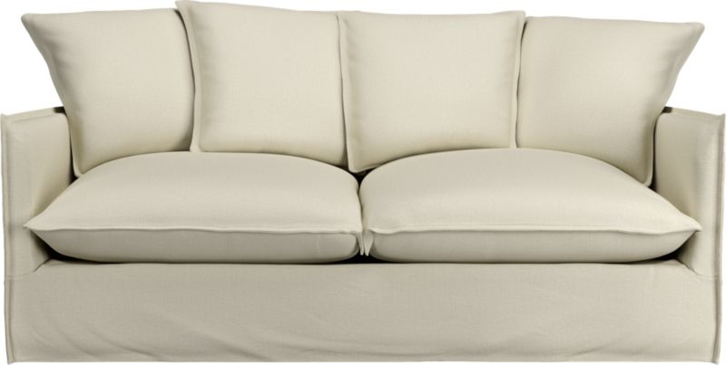 "Slipcover for Oasis Apartment Sofa is 100% linen tailored fresh with a fashionable flanged edge and casual drape at the floor.<br /><br />Additional <a href=""http://crateandbarrel.custhelp.com/cgi-bin/crateandbarrel.cfg/php/enduser/crate_answer.php?popup=-1&p_faqid=125&p_sid=DMUxFvPi"">slipcovers</a> available below and through stores featuring our Furniture Collection.<br /><br />After you place your order, we will send a fabric swatch via next day air for your final approval. We will contact you to verify both your receipt and approval of the fabric swatch before finalizing your order.<br /><br /><NEWTAG/><ul><li>100% linen</li><li>Dry cleaning rec"