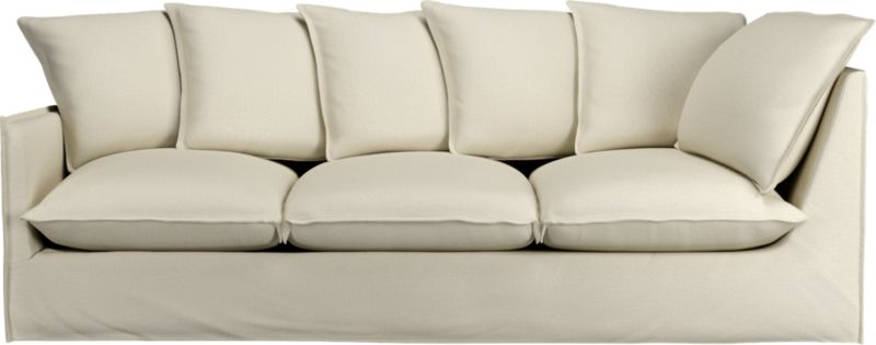 "A modern lounge sofa so relaxed, it feels like you're sinking into a cloud. Sheltering box frame with super-narrow padded arms and super-fluffy seat and back cushions is fitted in a 100% linen slipcover tailored fresh with a fashionable flanged edge and casual drape at the floor.<br /><br />Additional <a href=""http://crateandbarrel.custhelp.com/cgi-bin/crateandbarrel.cfg/php/enduser/crate_answer.php?popup=-1&p_faqid=125&p_sid=DMUxFvPi"">slipcovers</a> available below and through stores featuring our Furniture Collection.<br /><br />After you place your order, we will send a fabric swatch via next day air for your final approval. We will contact you to verify both your receipt and approval of the fabric swatch before finalizing your order.<br /><br /><NEWTAG/><ul><li>Eco-friendly construction</li><li>Certified sustainable, kiln-dried hardwood frame</li><li>Seat cushions are soy-based foam wrapped in a 50/50 mix of feather-down blend and fiber, encased in downproof ticking</li><li>Sinuous spring suspension</li><li>Slipcovered in 100% linen</li><li>Back cushions are feather-down blend with fiber blend encased in downproof ticking</li><li>Removable slipcovers are machine washable; dry cleaning recommended</li><li>See additional frame options below</li><li>Made in North Carolina, USA</li></ul>"