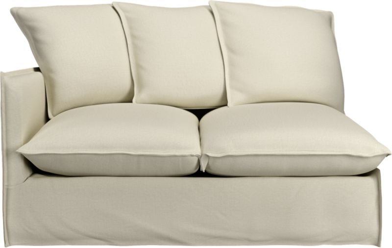 "A modern lounge loveseat so relaxed, it feels like you're sinking into a cloud. Sheltering box frame with super-narrow padded arms and super-fluffy seat and back cushions is fitted in a 100% linen slipcover tailored fresh with a fashionable flanged edge and casual drape at the floor.<br /><br />Additional <a href=""http://crateandbarrel.custhelp.com/cgi-bin/crateandbarrel.cfg/php/enduser/crate_answer.php?popup=-1&p_faqid=125&p_sid=DMUxFvPi"">slipcovers</a> available below and through stores featuring our Furniture Collection.<br /><br />After you place your order, we will send a fabric swatch via next day air for your final approval. We will contact you to verify both your receipt and approval of the fabric swatch before finalizing your order.<br /><br /><NEWTAG/><ul><li>Eco-friendly construction</li><li>Certified sustainable, kiln-dried hardwood frame</li><li>Seat cushions are soy-based foam wrapped in a 50/50 mix of feather-down blend and fiber, encased in downproof ticking</li><li>Sinuous spring suspension</li><li>Slipcovered in 100% linen</li><li>Back cushions are feather-down blend with fiber blend encased in downproof ticking</li><li>Removable slipcovers are machine washable; dry cleaning recommended</li><li>Made in North Carolina, USA</li></ul><br /><ul><li>See additional frame options below</li><li>Made in Nort"