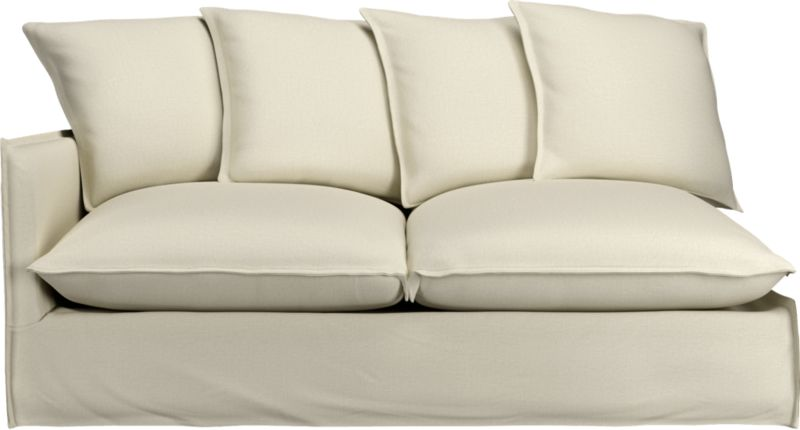 "A modern lounge sofa so relaxed, it feels like you're sinking into a cloud. Sheltering box frame with super-narrow padded arms and super-fluffy seat and back cushions is fitted in a 100% linen slipcover tailored fresh with a fashionable flanged edge and casual drape at the floor.<br /><br />Additional <a href=""http://crateandbarrel.custhelp.com/cgi-bin/crateandbarrel.cfg/php/enduser/crate_answer.php?popup=-1&p_faqid=125&p_sid=DMUxFvPi"">slipcovers</a> available below and through stores featuring our Furniture Collection.<br /><br />After you place your order, we will send a fabric swatch via next day air for your final approval. We will contact you to verify both your receipt and approval of the fabric swatch before finalizing your order.<br /><br /><NEWTAG/><ul><li>Eco-friendly construction</li><li>Certified sustainable, kiln-dried hardwood frame</li><li>Seat cushions are soy-based foam wrapped in a 50/50 mix of feather-down blend and fiber, encased in downproof ticking</li><li>Sinuous spring suspension</li><li>Slipcovered in 100% linen</li><li>Back cushions are feather-down blend with fiber blend encased in downproof ticking</li><li>Removable slipcovers are machine washable; dry cleaning recommended</li><li>Benchmade</li><li>See additional frame options below</li><li>Made in North Carolina, USA</li></ul>"