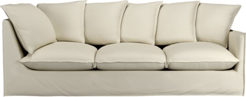 "A modern lounge sofa so relaxed, it feels like you're sinking into a cloud. Sheltering box frame with super-narrow padded arms and super-fluffy seat and back cushions is fitted in a 100% linen slipcover tailored fresh with a fashionable flanged edge and casual drape at the floor.<br /><br />Additional <a href=""http://crateandbarrel.custhelp.com/cgi-bin/crateandbarrel.cfg/php/enduser/crate_answer.php?popup=-1&p_faqid=125&p_sid=DMUxFvPi"">slipcovers</a> available below and through stores featuring our Furniture Collection.<br /><br />After you place your order, we will send a fabric swatch via next day air for your final approval. We will contact you to verify both your receipt and approval of the fabric swatch before finalizing your order.<br /><br /><NEWTAG/><ul><li>Eco-friendly construction</li><li>Certified sustainable, kiln-dried hardwood frame</li><li>Seat cushions are soy-based foam wrapped in a 50/50 mix of feather-down blend and fiber, encased in downproof ticking</li><li>Sinuous spring suspension</li><li>Slipcovered in 100% linen</li><li>Back cushions are feather-down blend with fiber blend encased in downproof ticking</li><li>Removable slipcovers are machine washable; dry cleaning recommended</li><li>Made in North Carolina, USA</li></ul><br /><ul><li>See additional frame options below</li><li>Made in North Carolina,"
