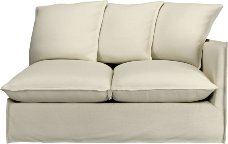 "A modern lounge loveseat so relaxed, it feels like you're sinking into a cloud. Sheltering box frame with super-narrow padded arms and super-fluffy seat and back cushions is fitted in a 100% linen slipcover tailored fresh with a fashionable flanged edge and casual drape at the floor.<br /><br />Additional <a href=""http://crateandbarrel.custhelp.com/cgi-bin/crateandbarrel.cfg/php/enduser/crate_answer.php?popup=-1&p_faqid=125&p_sid=DMUxFvPi"">slipcovers</a> available below and through stores featuring our Furniture Collection.<br /><br />After you place your order, we will send a fabric swatch via next day air for your final approval. We will contact you to verify both your receipt and approval of the fabric swatch before finalizing your order.<br /><br /><NEWTAG/><ul><li>Eco-friendly construction</li><li>Certified sustainable, kiln-dried hardwood frame</li><li>Seat cushions are soy-based foam wrapped in a 50/50 mix of feather-do"