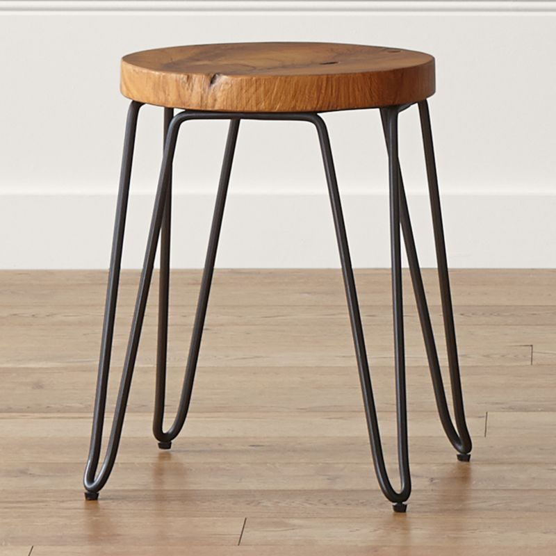 Cross-sectioned from discarded teak root, the Origin dining stool reveals and preserves the natural rings, knots and splits that tell a tree's unique story. This organic, versatile stool can be used for seating at a dining table or as a side table. <NEWTAG/><ul><li>Teak root with clear lacquer topcoat</li><li>Rod iron base with dark brown finish</li><li>Each piece is unique and will display characteristics of natural wood</li><li>Expansion and contraction of wood may occur</li><li>Seat diameter will vary</li><li>Made in Indonesia</li></ul><br />