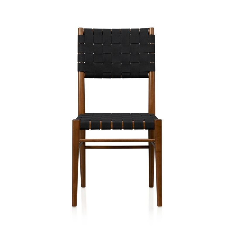 Gentle curves, honest materials and streamlined contours are the hallmarks of a classic, Scandinavian design such as our Oslo side chair. Black, heavy cotton webbing weaves a sturdy back and seat around a sleek handcrafted frame of solid beechwood, stained a rich walnut color. <NEWTAG/><ul><li>Solid beechwood</li><li>Walnut stain and clear lacquer finish</li><li>Heavy black cotton-blend webbed seat and back</li><li>Made in Italy</li></ul><br />