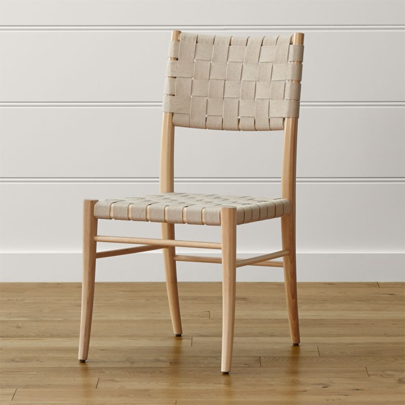 Gentle curves, honest materials and streamlined contours are the hallmarks of classic Scandinavian design. Oslo side chair's natural heavy cotton-blend webbing weaves a sturdy back and seat around a sleek handcrafted frame of solid beechwood. <NEWTAG/><ul><li>Solid beechwood with clear lacquer finish</li><li>Heavy natural cotton-blend webbed seat and back</li><li>Made in Italy</li></ul><br />