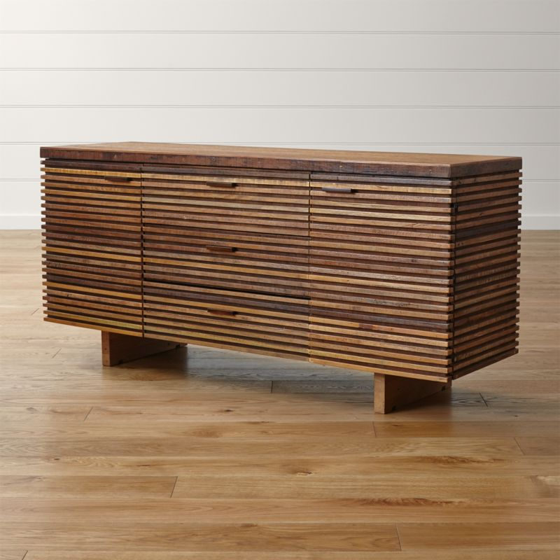 Modern dining storage with a rich history. The Paloma II large sideboard tells a story of timber reclamation from around the world with its distinctive, handcrafted design layering precision-cut strips of peroba wood repurposed from homes in Brazil. The striking design is hand-assembled in a horizontal Prairie-style continuum, displaying a beautiful range of natural wood grain in dark and honeyed browns. <NEWTAG/><ul><li>Reclaimed peroba wood case</li><li>Reclaimed Australian hardwood top</li><li>Clear water-based lacquer finish</li><li>Each piece is unique due to the natural aging process of reclaimed woods</li><li>3 drawers with metal glides and 2 doors with solid mahogany pulls</li><li>Leg levelers</li><li>Cord management cutouts</li><li>Made in Indonesia</li></ul><br />