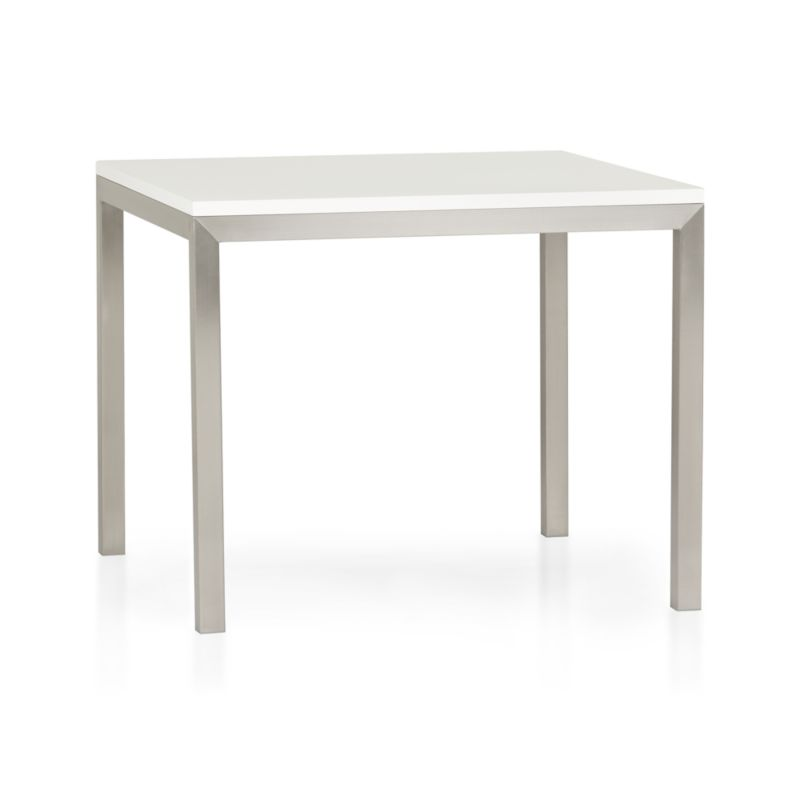 Start with a great base. Top it off with a clean, hard-working top. Voila—the perfect table. Stainless-steel frame with a contemporary matte finish supports with clean simple lines. Highly durable engineered wood top with a crisp white powdercoat finish is heat-resistant and anti-microbial. A natural for the kitchen, also works as an office desk or worktable. Seats four.<br /><br /><NEWTAG/><ul><li>Stainless-steel base with matte finish</li><li>Low-emission engineered wood with white powdercoat finish</li><li>Seats four</li><li>Made in USA and China </li></ul>