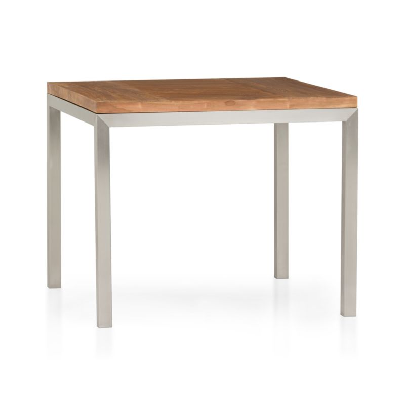 Start with a great base. Top it off with an amazing top. Voila—the perfect table. Stainless-steel frame with a contemporary matte finish supports with clean simple lines. Gorgeous wood top is handcrafted from repurposed teak from Southeast Asia with variations in wood grains, texture and color, knots and other naturally occurring characteristics that add to the distinct character. Seats four.<br /><br /><NEWTAG/><ul><li>100% reclaimed, unfinished teak</li><li>Naturally occurring texture and knots</li><li>Stainless-steel base with matte finish</li><li>Clear powdercoat finish on base</li><li>Seats four</li><li>Clean with mild soap and water</li><li>Made in Indonesia and China </li></ul>