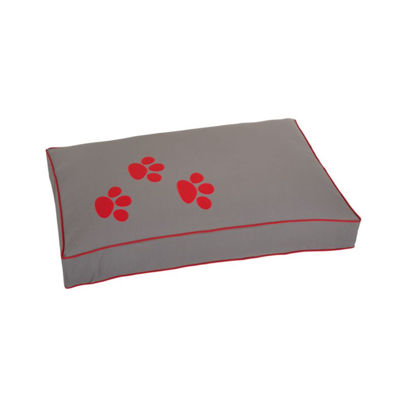 Plush bed covered in handsome grey cotton canvas and trimmed with stylish red piping will please any pup. Embroidered red paw print completes the tailored look.<br /><br /><NEWTAG/><ul><li>100% cotton shell</li><li>100% polyester fill</li><li>Machine wash removable cover</li><li>Made in India</li></ul>