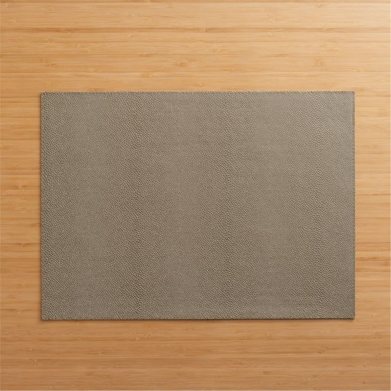 Pebbled vinyl placemat decks out in warm brown with the look of richly grained leather. Easy-care option in a smart neutral dresses up or down.<br /><br /><NEWTAG/><ul><li>100% PVC with flocked backing</li><li>Clean with damp cloth</li><li>Made in Turkey</li></ul>