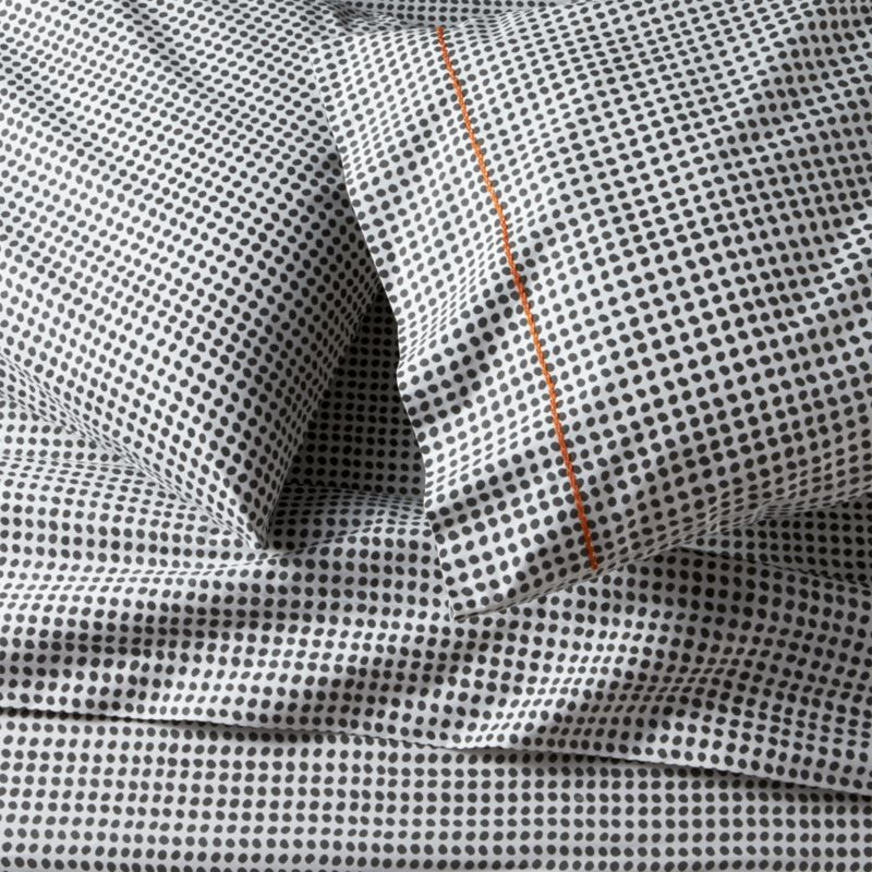 Traditional block-printed fabric emerges as a new neutral, pebbled with casual polka dots that play pattern and solid with a wide range of bedding. Hand-blocked pattern is printed on soft cotton running the full length of the sheet. Pillows are accented with a single line of hand-embroidered chain stitch. Sheet set includes one flat sheet, one fitted sheet and two standard pillowcases. Bed pillows also available.<br /><br /><NEWTAG/><ul><li>Handcrafted</li><li>100% cotton percale</li><li>200-thread-count</li><li>Machine wash, tumble dry low</li><li>Made in India</li></ul>