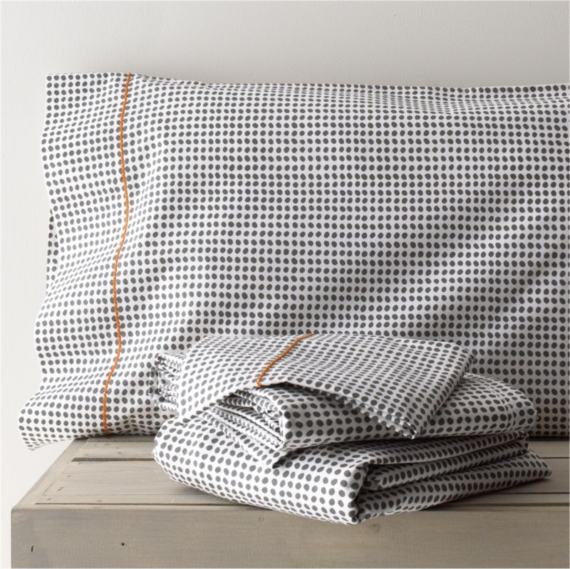 Traditional block-printed fabric emerges as a new neutral, pebbled with casual polka dots that play pattern and solid with a wide range of bedding. Hand-blocked pattern is printed on soft cotton running the full length of the sheet. Pillows are accented with a single line of hand-embroidered chain stitch. Sheet set includes one flat sheet, one fitted sheet and two king pillowcases. Bed pillows also available.<br /><br /><NEWTAG/><ul><li>Handcrafted</li><li>100% cotton percale</li><li>200-thread-count</li><li>Machine wash, tumble dry low</li><li>Made in India</li></ul>