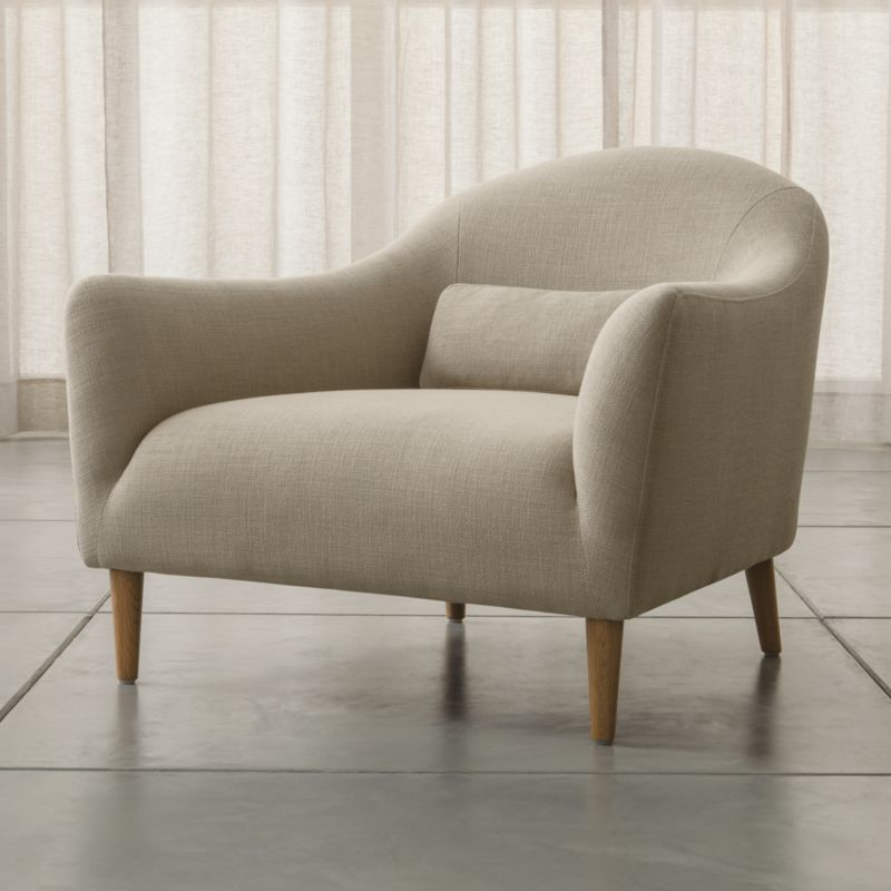 Sleek curves flare out to invite you in to this affordable furniture collection for small rooms and apartments by London-based designer Bethan Gray. Every turn of the chair's graceful tight back and plush seat is hugged by a textured, linen-blend weave. A coordinating kidney pillow supports your lower back; tapered legs are made of solid white oak. <NEWTAG/><ul><li>Designed by Bethan Gray</li><li>Frame is made with a certified sustainable solid wood and engineered hardwood</li><li>Sinuous wire spring and synthetic web suspension systems</li><li>High-resiliency, high-density foam and polyfiber back and seat cushions</li><li>Fiber-down blend kidney pillow encased in downproof ticking</li><li>Solid white oak legs with clear lacquer finish</li><li>Material origin: see swatch</li><li>Made in China</li></ul>