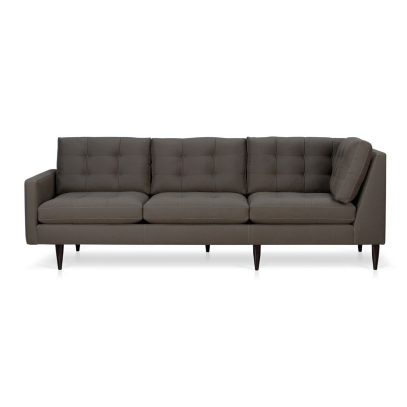 It was the most familiar furniture shape of the 1960s. And now it's coming back to a living room near you. This time around, it has tufted and buttoned cushions for a more classic, tailored look that sits deep and firm, but lets you slouch in comfort. Chic graphite grey fabric is treated with a new stain-repellant system that's actually in each fiber. Petrie is authentically styled light and lean with slim top-stitched track arms and trim hardwood legs stained a dark ebony finish called deco.<br /><br />After you place your order, we will send a fabric swatch via next day air for your final approval. We will contact you to verify both your receipt and approval of the fabric swatch before finalizing your order.<br /><br /><NEWTAG/><ul><li>Eco-friendly construction</li><li>Certified sustainable, kiln-dried hardwood frame</li><li>Seat cushions are soy-based polyfoam with fiber wrapped in downproof ticking</li><li>Back cushions are a blend of virgin and recycled fibers</li><li>Sinuous wire spring suspension</li><li>Stain-resistant finish for maximum cleanability</li><li>Cotton-polyester blend fabric</li><li>Topstitched and button-tufted detail</li><li>Benchmade</li><li>See additional frame options below</li><li>Made in Virginia, USA</li></ul>