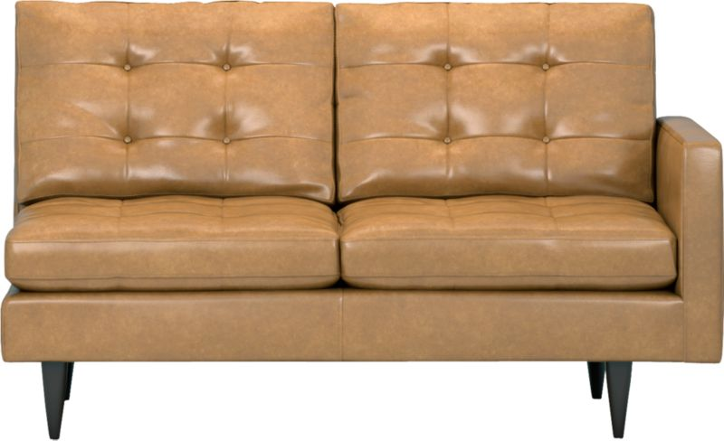 It was the most familiar furniture shape of the 1960s. And now it's coming back to a living room near you as a luxe leather sectional. This time around, it has tufted and buttoned cushions for a more classic, tailored look that sits deep and firm, but lets you slouch in comfort. Petrie is authentically styled light and lean in top-grain, full-aniline leather with slim track arms and trim hardwood legs stained a dark ebony finish called deco.<br /><br />After you place your order, we will send a leather swatch via next day air for your final approval. We will contact you to verify both your receipt and approval of the leather swatch before finalizing your order.<br /><br /><NEWTAG/><ul><li>Eco-friendly construction</li><li>Certified sustainable, kiln-dried hardwood frame</li><li>Seat cushions are soy-based polyfoam with fiber wrapped in downproof ticking</li>&lt