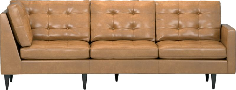 It was the most familiar furniture shape of the 1960s. And now it's coming back to a living room near you as a luxe leather sectional. This time around, it has tufted and buttoned cushions for a more classic, tailored look that sits deep and firm, but lets you slouch in comfort. Petrie is authentically styled light and lean in top-grain, full-aniline leather with slim track arms and trim hardwood legs stained a dark ebony finish called deco.<br /><br /><NEWTAG/>After you place your order, we will send a leather swatch via next day air for your final approval. We will contact you to verify both your receipt and approval of the leather swatch before finalizing your order.<br /><ul><li>Eco-friendly construction</li><li>Certified sustainable, kiln-dried hardwood frame</li><li>Seat cushions are soy-based polyfoam with fiber wrapped in downproof ticking</li><li>Back cu