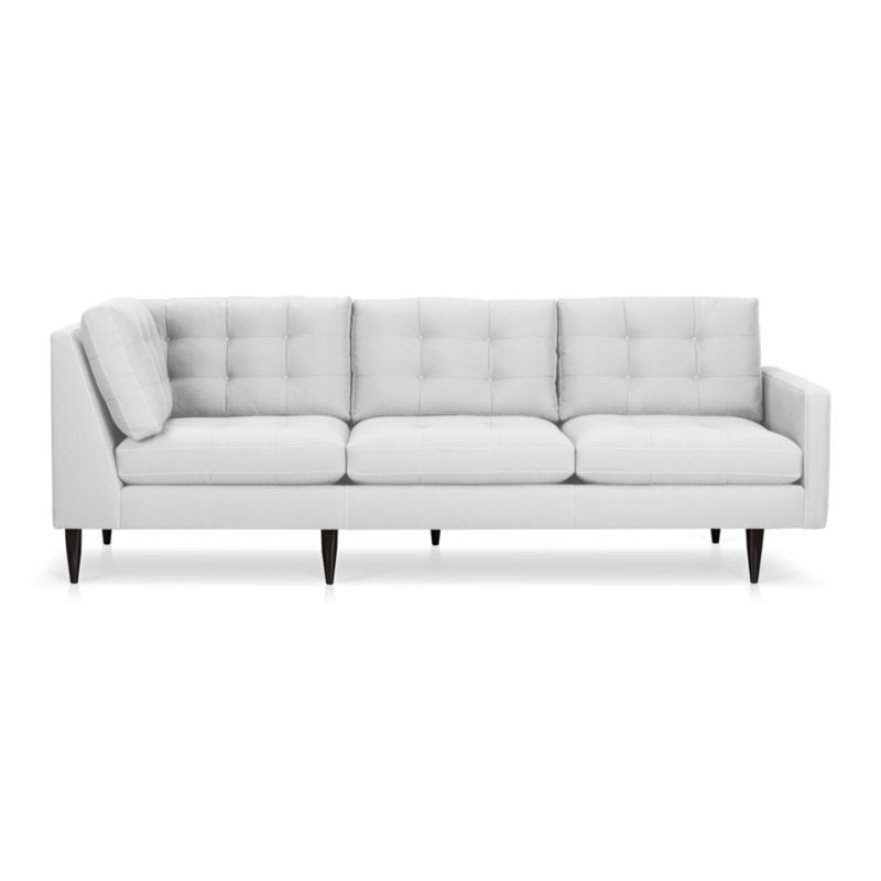 It was the most familiar furniture shape of the 1960s. And now it's coming back to a living room near you. This time around, it has tufted and buttoned cushions for a more classic, tailored look that sits deep and firm, but lets you slouch in comfort. Petrie is authentically styled light and lean with slim top-stitched track arms and trim hardwood legs stained a dark ebony finish called deco.<br /><br />After you place your order, we will send a fabric swatch via next day air for your final approval. We will contact you to verify both your receipt and approval of the fabric swatch before finalizing your order.<br /><br /><NEWTAG/><ul><li>Eco-friendly construction</li><li>Certified sustainable, kiln-dried hardwood frame</li><li>Seat cushions are soy-based polyfoam with fiber wrapped in downproof ticking</li><li>Back cushions are a blend of virgin and recycled fibers</li><li>Sinuous wire spring suspension</li><li>Cotton-polyester blend fabric</li><li>Topstitched and button-tufted detail</li><li>Benchmade</li><li>See additional frame options below</li><li>Made in Virginia, USA</li></ul>
