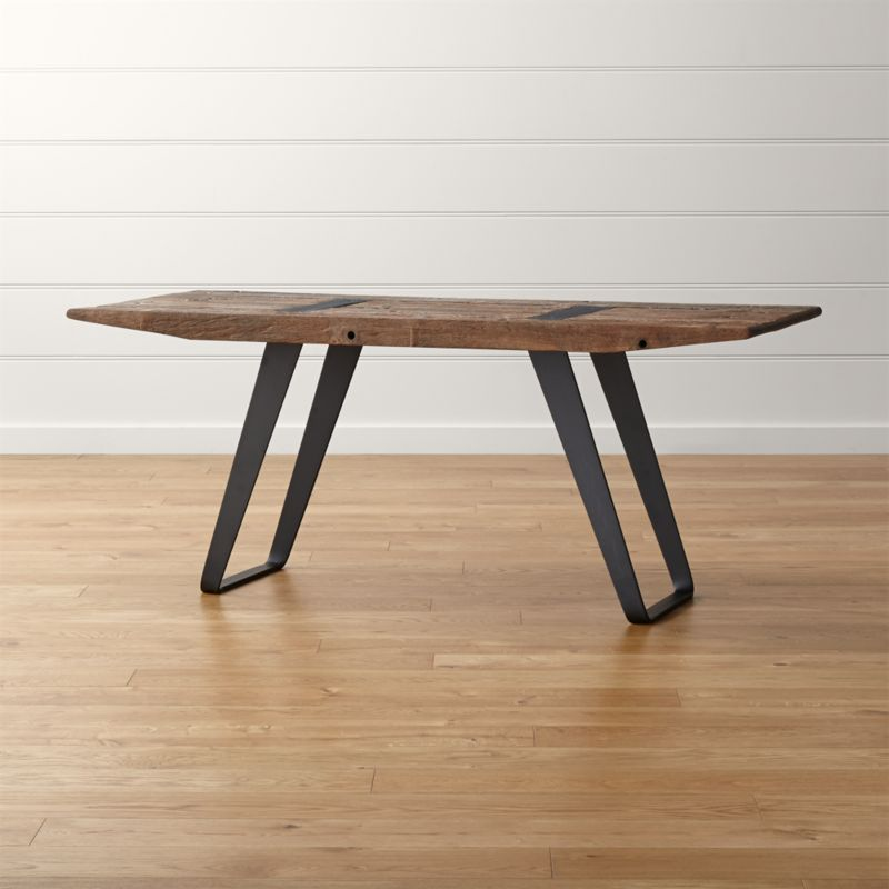 Handcrafted from reclaimed Brazilian telephone poles, this unique table's incredible character stems from true distressing by time and nature. Finished with a wing-like beveled edge in a nod to the name, Phoenix's rustic top rises from a distinctive black steel base that's angled just so. <NEWTAG/><ul><li>Reclaimed wood top with beeswax topcoat</li><li>Each desk is unique due to color variation, knots and wood grain.</li><li>Made in Mexico</li></ul><li>As with all solid woods, expansion and contraction may occur with seasonal changes in humidity.</li><li>Steel base with black finish and lacquer</li><li>Black iron plates</li><li>Made in Mexico</li></ul><br />