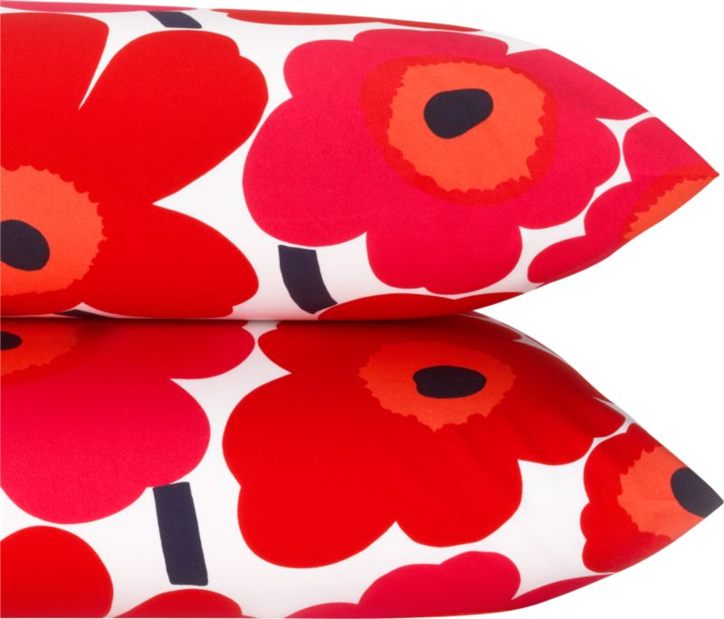 "Designed in 1964 by Maija Isola, the Unikko (""poppy"") design has been the most popular Marimekko print since its introduction. Challenging the common notion of decorative florals, Unikko broke from tradition with its creative pop art interpretation in bold, simplified pattern and bright color. Reproduced in infinite color combinations over its 47-year history, the pattern remains current while symbolizing the free spirit of its designer and those who admire it. Pieni Unikko is scaled between the original Unikko and the Mini-Unikko patterns. Bed pillows also available.<br /><br /><NEWTAG/><ul><li>Pattern designed by Maija Isola and Kristina Isola; 1964/2000</li><li>100% cotton percale</li><li>300-thread-count</li><li>Machine wash cold</li><li>Made in Mexico</li></ul>"