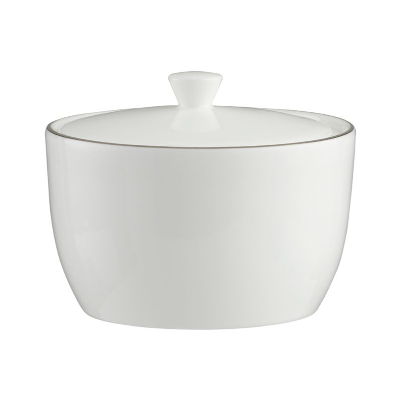 Fine platinum bands rim this refined serving piece in beautiful white bone china. Simple styling coordinates with a wide variety of dinnerware.<br /><br /><strong>Please note:</strong> This sugar bowl with lid is discontinued. When our current inventory is sold out, it is unlikely we will be able to obtain more.<br /><br /><NEWTAG/><ul><li>Bone china</li><li>Dishwasher-safe</li><li>Made in Japan</li></ul>by Nikko Ceramics<br />