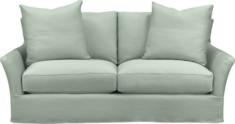 "Modern meets grace in this versatile new classic for living or family room. Unexpected clean, slim arms outwardly gesture, curve and wrap back to create a soft, relaxed silhouette from all angles. Luxe cushions relax deep. Slipcover is prewashed for a soft lived-in touch.<br /><br />Additional <a href=""http://crateandbarrel.custhelp.com/cgi-bin/crateandbarrel.cfg/php/enduser/crate_answer.php?popup=-1&p_faqid=125&p_sid=DMUxFvPi"">slipcovers</a> available below and through stores featuring our Furniture Collection.<br /><br />After you place your order, we will send a fabric swatch via next day air for your final approval. We will contact you to verify both your receipt and approval of the fabric swatch before finalizing your order.<br /><br /><NEWTAG/><ul><li>Eco-friendly construction</li><li>Certified sustainable, kiln-dried hardwood frame</li><li>Seat cushions with inner spring coil system surrounded by polyfoam with feather-down blend encased in downproof ticking</li><li>Flexolator spring suspension</li><li>Back cushions are 100% down mix wrapped in downproof ticking</li><li>Polyester-cotton blend slipcover with topstitching</li><li>Includes two 23""sq. knife-edge throw pillows</li><li>Benchmade</li><li>See additional frame options below</li><li>Made in North Carolina, USA</li></ul>"
