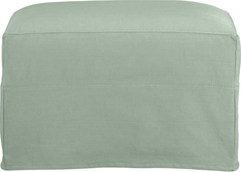 "Modern meets grace in this versatile new classic for living or family room. Slipcover for Portico Ottoman is prewashed poly-cotton blend for a soft lived-in touch.<br /><br />Additional <a href=""http://crateandbarrel.custhelp.com/cgi-bin/crateandbarrel.cfg/php/enduser/crate_answer.php?popup=-1&p_faqid=125&p_sid=DMUxFvPi"">slipcovers</a> available below and through stores featuring our Furniture Collection.<br /><br />After you place your order, we will send a fabric swatch via next day air for your final approval. We will contact you to verify both your receipt and approval of the fabric swatch before finalizing your order.<br /><br /><NEWTAG/><ul><li>Polyester-cotton blend with topstitching</li><li>Machine wash</li><li>Made in North Carolina, USA</li></ul>"