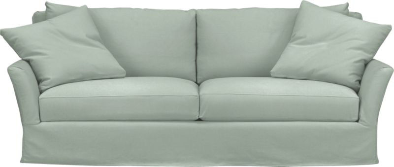 "Modern meets grace in this versatile new classic for living or family room. Slipcover for Portico Sofa is prewashed poly-cotton blend for a soft lived-in touch.<br /><br />Additional <a href=""http://crateandbarrel.custhelp.com/cgi-bin/crateandbarrel.cfg/php/enduser/crate_answer.php?popup=-1&p_faqid=125&p_sid=DMUxFvPi"">slipcovers</a> available below and through stores featuring our Furniture Collection.<br /><br />After you place your order, we will send a fabric swatch via next day air for your final approval. We will contact you to verify both your receipt and approval of the fabric swatch before finalizing your order.<br /><br /><NEWTAG/><ul><li>Polyester-cotton blend with topstitching</li><li>Machine wash</li><li>Made in North Carolina, USA</li></ul>"
