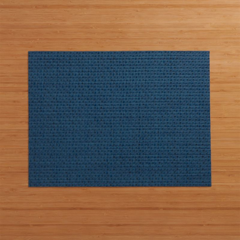 Deep blue vinyl textures the table in our exclusive Chilewich® woven placemat.<br /><br /><NEWTAG/><ul><li>100% woven vinyl</li><li>Hand wash</li><li>Made in USA</li></ul>