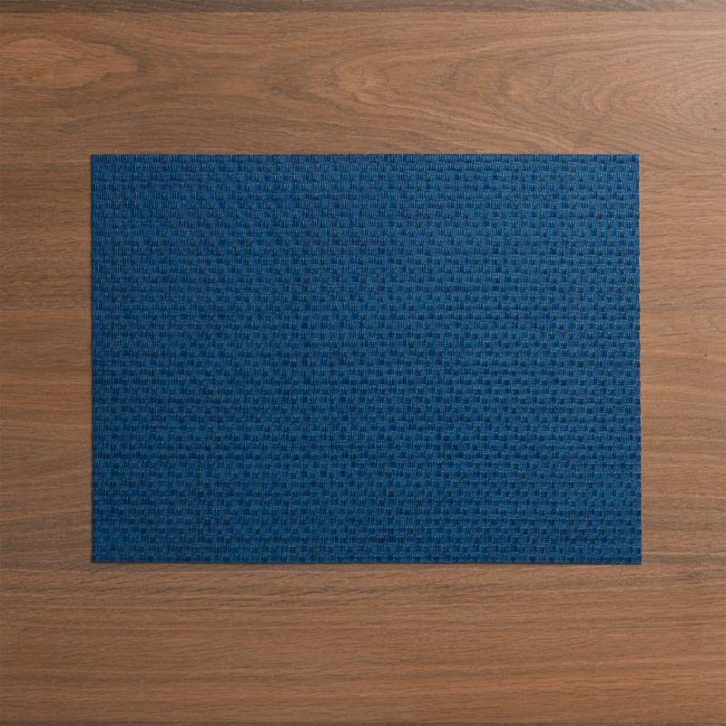 Deep blue vinyl textures the table in our exclusive Chilewich® woven placemat.<br /><br /><NEWTAG/><ul><li>100% woven vinyl</li><li>Hand wash</li><li>Made in USA</li></ul>